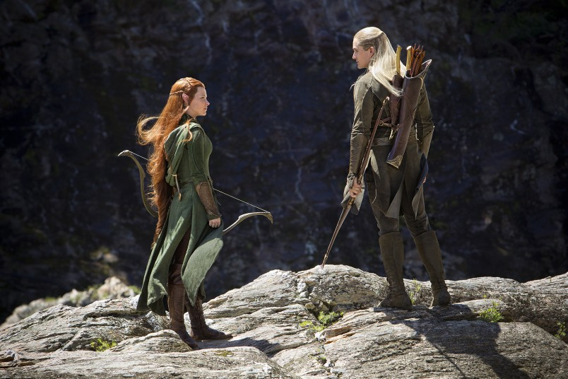 Tauriel (Evangeline Lilly) and Legolas (Orlando Bloom) take stock