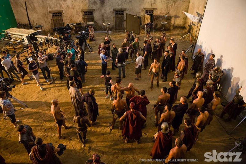 Stunt performers prepare for a fight scene