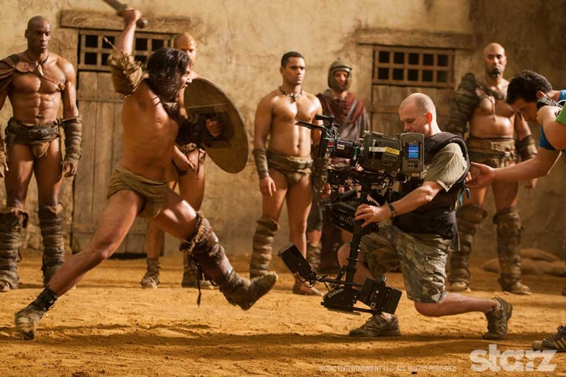 Manu Bennett lunges at Steadicam operator Cameron McLean